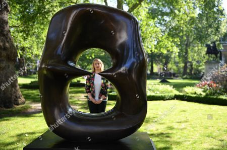 A Christie's auction house staff looks over British artist Henry Moore's artwork 'Working Model for Oval with Points bronze with brown patina' (1986) during the 'Sculpture in the Square' art sale preview at St. James's Square in London, Britain, 15 May 2019. The sculpture is estimated to fetch 800,000 - 1.2 million euros at auction in London on 17 June.