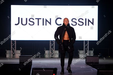 Australian swimmer Michael Klim presents a creation by Justin Cassin during the Mercedes-Benz Fashion Week Australia at Luna Park in Sydney, 15 May 2019. The fashion event runs from 12 to 17 May.