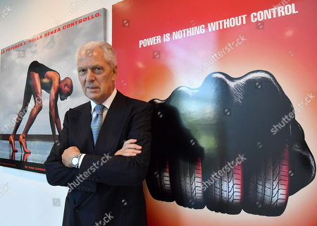 Stock Image of The CEO and Vice President of Pirelli, Marco Tronchetti Provera, poses in front of two advertising boards with the slogan 'Power is nothing without control' in the Pirelli headquaters prior to the Annual Report 2019 in Milan, Italy, 15 May 2019.