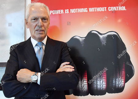 Stock Photo of The CEO and Vice President of Pirelli, Marco Tronchetti Provera, poses in front of two advertising boards with the slogan 'Power is nothing without control' in the Pirelli headquaters prior to the Annual Report 2019 in Milan, Italy, 15 May 2019.