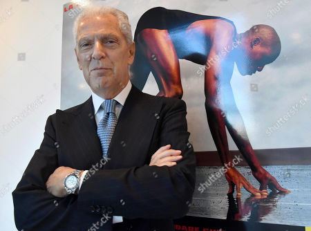 The CEO and Vice President of Pirelli, Marco Tronchetti Provera, poses in front of two advertising boards with the slogan 'Power is nothing without control' in the Pirelli headquaters prior to the Annual Report 2019 in Milan, Italy, 15 May 2019.