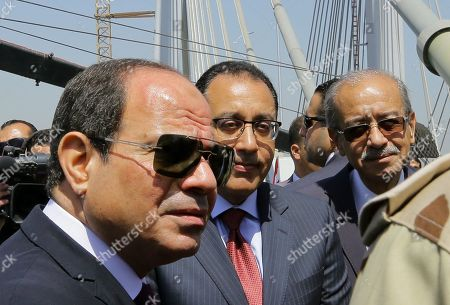 Stock Picture of Egyptian President Abdel Fattah al-Sisi (L), Prime Minister Mostafa Madbouli (C) and Presidential Adviser Sherif Ismail (R) attend the opening of the Rawd Al-Faraj bridge in Shobra district, Cairo, Egypt, 15 May l 2019. According to reports, Egypt requested to register the construction as the world's widest suspension bridge on the Guinness World Records. The length of the bridge is 720 meters and 14 meters above the level of the River Nile to facilitate the riverine movement. The suspension bridge is located within the third phase of the Rawd Al-Faraj axis, starts from Al-Khalafawi Square on the Corniche of the Nile in front of the Aghakhan Towers opposite the Nile on Al-Warraq Island passing through Bashteel area.