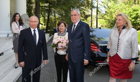 Russian President Vladimir Putin (front L), Austrian Federal President Alexander Van der Bellen (2-R), his wife Doris Schmidauer (2-L) and Austrian Foreign Minister Karin Kneissl (R) meet in the Black Sea resort of Sochi, Russia, 15  May 2019. Austrian Federal President is on a working visit to Russia.