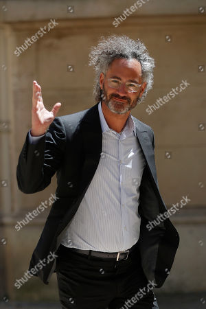 Alex Karp, Chief Executive Officer of Palantir, arrives for the Tech for Good summit in Paris, in Paris. World leaders and tech bosses meet Wednesday in Paris to discuss ways to prevent social media from spreading deadly ideas
