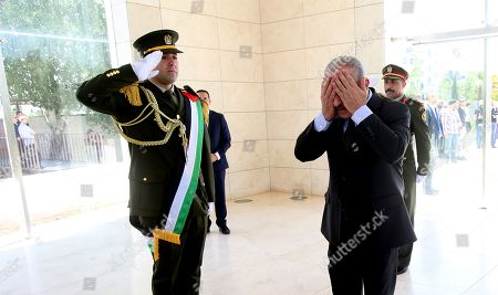 Palestinian Prime Minister Mohammad Shtayyeh (R) prepares to lay a wreath at late Palestinian leader Yasser Arafat grave during a rally marking the 71st anniversary of the Palestinian Nakba, in the west bank city of Ramallah, 15 May 2019. Nakba Day, or Day of the Catastrophe, which is marked on 15 May to commemorate the expulsion of more than 700,000 Palestinians from their land in the war surrounding the establishment of the state of Israel.
