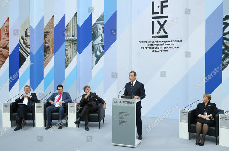 Stock Image of Russian Prime Minister Dmitry Medvedev (2-R) delivers a speech as Austrian designer, co-founder, Design Principal and CEO of Coop Himmelb(l)au Wolf D. Prix (L),  Former President of the American Association of International Private Law and Professor at Heidelberg Center for Latin America Jose Moreno Rodriguez (2-L), Dutch architect, professor and urbanist, MVRDV co-founder Winy Maas (3-L) and  United Nations High Commissioner for Human Rights, Chile's former President Michelle Bachelet (R) listen during a plenary session 'The Art of Law' at the the St. Petersburg International Legal Forum (SPBILF) in St. Petersburg, Russia, 15 May 2019. SPBILF-2019 takes place from 14 to 18 May in St.Petersburg.