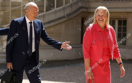 Stock Image of IBM CEO Virginia Rometty, right, and French cosmetics giant L'Oreal CEO Jean-Paul Agon arrive for the Tech for Good summit, in Paris. World leaders and tech bosses meet Wednesday in Paris to discuss ways to prevent social media from spreading deadly ideas