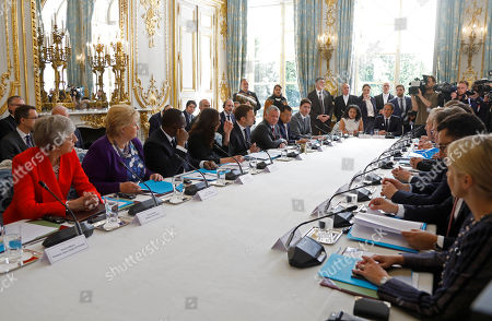 French President Emmanuel Macron and New Zealand's Prime Minister Jacinda Ardern attend a launching ceremony for the 'Christchurch Call' against terrorism at the Elysee Palace in Paris, France, 15 May 2019. Sitting at the table are (L-R) British Prime Minister Theresa May, Norwegian Prime Minister Erna Solberg, Senegalese President Macky Sall, New Zeland Prime Minister Jacinda Ardern, French President Emmanuel Macron, Jordan King Abdullah II, Indonesian Vice President Jusuf Kalla, Canadian Prime Minister Justin Trudeau. A high level summit held in Paris aims at ways to tackle and eliminate terrorism and violent extremist content online. Several world leaders and tech bosses are meeting in Paris to find ways to stop acts of violent extremism from being shown online.