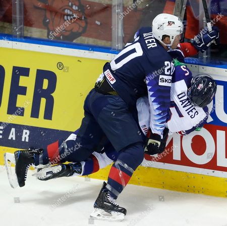 Ryan Sutter of the US, left, checks Great Britain's Ben Davies, right, during the Ice Hockey World Championships group A match between the United States and Great Britain at the Steel Arena in Kosice, Slovakia