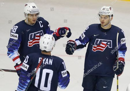 Stock Picture of Alex Debrincat of the US, right, celebrates with teammates Patrick Kane, left, and Derek Ryan, center, after scoring his sides fourth goal during the Ice Hockey World Championships group A match between the United States and Great Britain at the Steel Arena in Kosice, Slovakia
