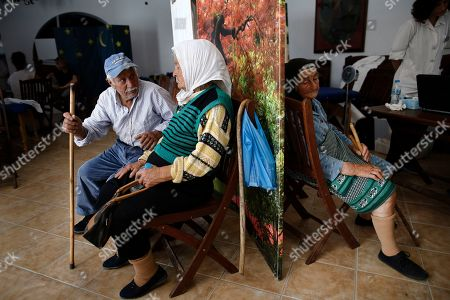 Stavros Prassinos (L), 84, Evdokia Sigala (C), 79 and Fani Prasinou (2nd R), 87, wait to be examined by the members of the doctors team called 'Anagennissi and Proodos' (Renaissance and Progress), inside the cultural center during their mission on the Greek island of Donoussa, in the Aegean sea, Greece, 03 May 2019. 'Anagennissi and Proodos' launched in 2008, and its primary purpose is to fill in the health care shortages faced by the inhabitants of the border regions of Greece, and in particular the 30 remote islands, without any discrimination.