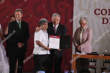 Mexican President Andres Manuel López Obrador (R), poses with professor Salomon Maximiliano (2L), during the event to repeal the education reform of his predecessor, Enrique Pena Nieto, in Mexico City, Mexico, 15 May 2019.
