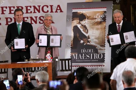 Mexican President Andres Manuel López Obrador (R), Public Education Secretary Esteban Moctezuma (L), and Government Secretary Olga Sanchez Cordero (C), speak during the event to repeal the education reform of former Mexican President Enrique Pena Nieto, in Mexico City, Mexico, 15 May 2019.
