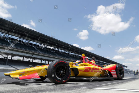 Ryan Hunter-Reay pulls of ofd the pit area during practice for the Indianapolis 500 IndyCar auto race at Indianapolis Motor Speedway, in Indianapolis