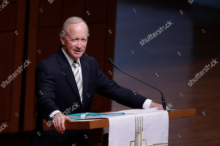"""Former Indiana Governor Mitch Daniels, president of Purdue University, speaks during a funeral service for Sen. Richard Lugar, in Indianapolis. Lugar was a longtime Republican senator and former Indianapolis mayor who's been hailed as an """"American statesman"""" since he died April 28 at age 87"""