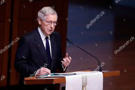 """Stock Picture of Senate Majority Leader Mitch McConnell speaks during a funeral service for Sen. Richard Lugar, in Indianapolis. Lugar was a longtime Republican senator and former Indianapolis mayor who's been hailed as an """"American statesman"""" since he died April 28 at age 87"""