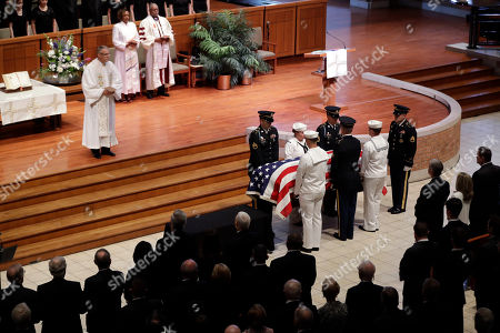 """A military honor guard escorts the casket of Sen. Richard Lugar during a funeral service, in Indianapolis. Lugar was a longtime Republican senator and former Indianapolis mayor who's been hailed as an """"American statesman"""" since he died April 28 at age 87"""