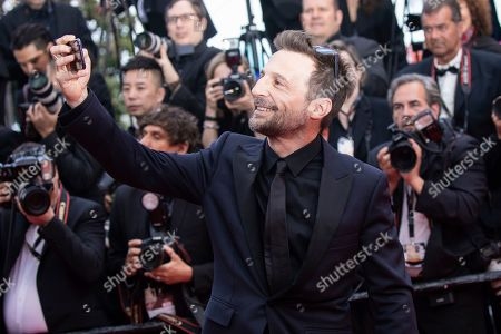 Mathieu Kassovitz poses for photographers upon arrival at the premiere of the film 'Les Miserables' at the 72nd international film festival, Cannes, southern France