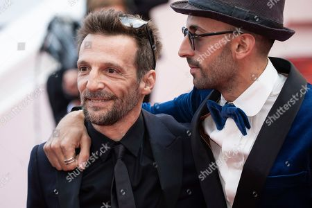 Mathieu Kassovitz, Jean Rene, JR. Mathieu Kassovitz and Jean Rene aka JR pose for photographers upon arrival at the premiere of the film 'Les Miserables' at the 72nd international film festival, Cannes, southern France