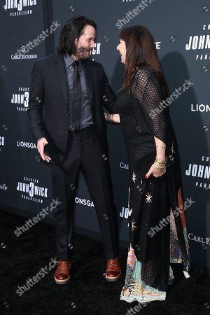 Keanu Reeves and Anjelica Huston