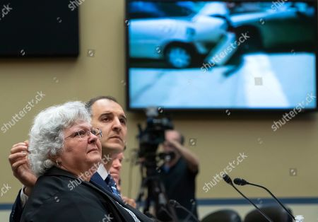Stock Picture of Susan Bro (L), mother of slain Charlottesville, Virginia protester Heather Heyer, is comforted George Selim (R) of the Anti-Defamation League, during a hearing of the House Oversight and Reform Committee, Civil Rights and Civil Liberties Subcommittee in the Rayburn House Office Building at the US Capitol in Washington, DC, USA, 15 May 2019. Bro testified about the death of her daughter in August 2017, for the hearing 'Confronting White Supremacy: The Consequences of Inaction.'