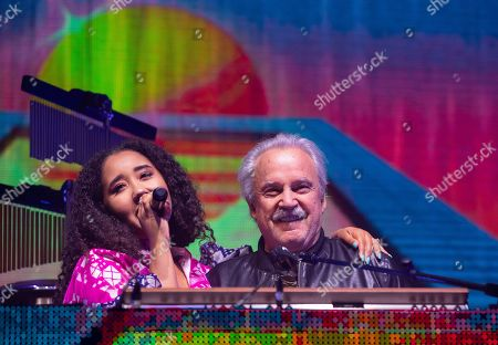Italian singer, songwriter, DJ and record producer Giorgio Moroder (R) performs with a singer during 'The Celebration of the '80s Tour' concert in Papp Laszlo Budapest Sports Arena, in Budapest, Hungary, 15 May 2019.