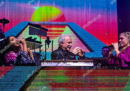 Italian singer, songwriter, DJ and record producer Giorgio Moroder (C) performs with singers during 'The Celebration of the '80s Tour' concert in Papp Laszlo Budapest Sports Arena, in Budapest, Hungary, 15 May 2019.