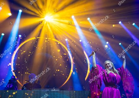 Italian singer, songwriter, DJ and record producer Giorgio Moroder (L) and a singer perform during 'The Celebration of the '80s Tour' concert in Papp Laszlo Budapest Sports Arena, in Budapest, Hungary, 15 May 2019.