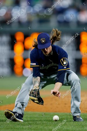 Milwaukee Brewers relief pitcher Josh Hader fields a grounder by Philadelphia Phillies' Cesar Hernandez, who was out at firwt during the ninth inning of a baseball game, in Philadelphia. Milwaukee won 5-2