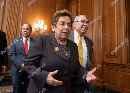 Donna Shalala, G. K. Butterfield, David Cicilline. Rep. Donna Shalala, D-Fla., center, former secretary of Health and Human Services, speaks with Rep. G. K. Butterfield, D-N.C., right, as they attend a Democratic event ahead of a House floor vote on the Health Care and Prescription Drug Package, at the Capitol in Washington, . Rep. David Cicilline, D-R.I., is at left rear
