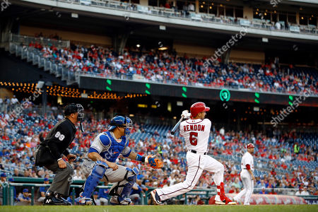Anthony Rendon, Wilson Ramos, Cory Blaser. Washington Nationals' Anthony Rendon, right, hits a ground rule double in front of New York Mets catcher Wilson Ramos and home plate umpire Cory Blaser in the first inning of a baseball game, in Washington. Adam Eaton scored on the play