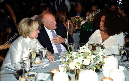 Hillary Clinton, Barry Diller, Oprah Winfrey. Former Secretary of State Hillary Clinton, left, Barry Diller and Oprah Winfrey chat at the Statue of Liberty Museum opening celebration at Battery Park, in New York