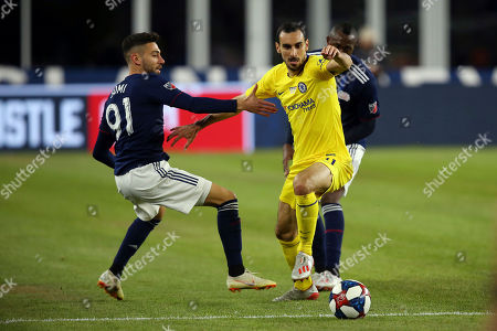 Chelsea's Davide Zappacosta, right, is defended by New England Revolution's Gabriel Somi (91) during the first half of a friendly soccer match, in Foxborough, Mass