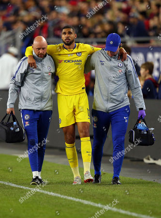 Chelsea's Ruben Loftus-Cheek, center, is helped off the field by training staff following an injury during the second half of a friendly soccer match against the New England Revolution, in Foxborough, Mass