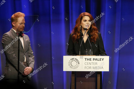 Stock Picture of Jesse Tyler Ferguson and Debra Messing
