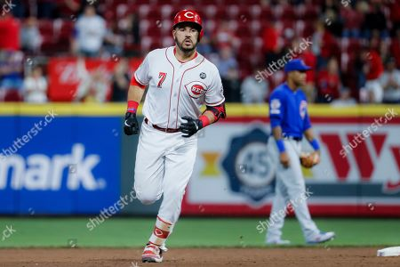 Cincinnati Reds' Eugenio Suarez runs the bases after hitting a solo home run off Chicago Cubs relief pitcher Carl Edwards Jr. in the eighth inning of a baseball game, in Cincinnati