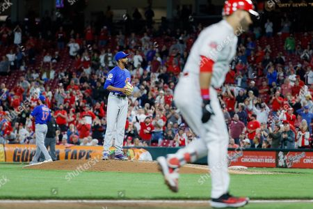 Eugenio Suarez, Carl Edwards Jr. Cincinnati Reds' Eugenio Suarez runs the bases after hitting a solo home run off Chicago Cubs relief pitcher Carl Edwards Jr. in the eighth inning of a baseball game, in Cincinnati