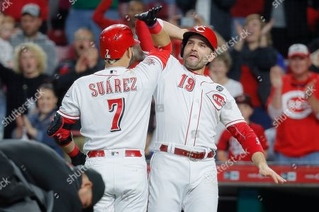 Eugenio Suarez, Joey Votto. Cincinnati Reds' Eugenio Suarez (7) celebrates with Joey Votto (19) after hitting a solo home run off Chicago Cubs relief pitcher Carl Edwards Jr. in the eighth inning of a baseball game, in Cincinnati