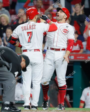 Eugenio Suarez, Joey Votto. Cincinnati Reds' Eugenio Suarez (7) celebrates with Joey Votto, right, after hitting a solo home run off Chicago Cubs relief pitcher Carl Edwards Jr. in the eighth inning of a baseball game, in Cincinnati