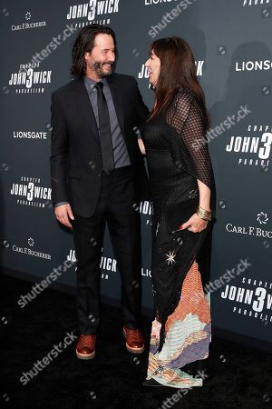 Keanu Reeves (L) and US actor Anjelica Huston arrivie for the premiere of Lionsgate's John Wick: Chapter 3 - Parabellum at the TCL Chinese Theatre IMAX in Hollywood, Los Angeles, California, USA, 15 May 2019. The movie opens in the US on 17 May 2019.