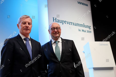Juergen Fitschen (L), chairman of the supervisory board and Rolf Buch (R), CEO attend the annual general meeting of real estate company Vonovia SE in Bochum, Germany, 16 May 2019.