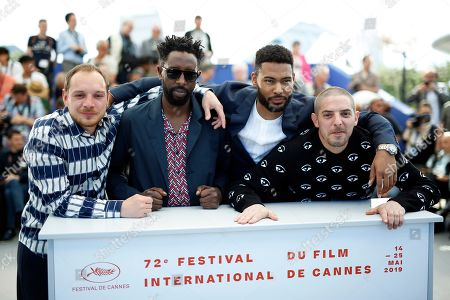 French actor Alexis Manenti, French director Ladj Ly, French actor Djebril Zonga and French actor Damien Bonnard pose during the photocall for 'Les Miserables' at the 72nd annual Cannes Film Festival, in Cannes, France, 16 May 2019. The movie is presented in the Official Competition of the festival which runs from 14 to 25 May.