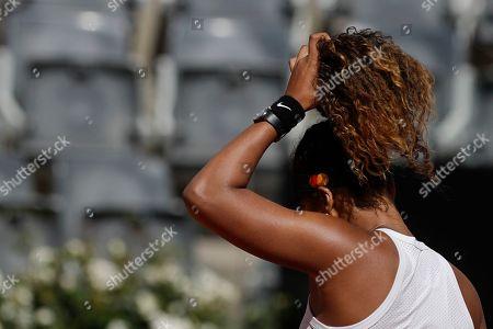Japan's Naomi Osaka prepares to serve the ball during her match against Slovakia's Dominika Cibulkova at the Italian Open tennis tournament, in Rome, Thursday, May, 16, 2019
