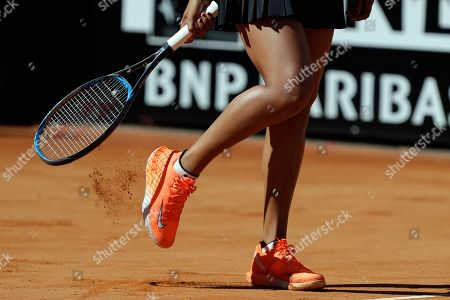 Japan's Naomi Osaka removes the court soil away from her shoe during her match against Slovakia's Dominika Cibulkova at the Italian Open tennis tournament, in Rome, Thursday, May, 16, 2019