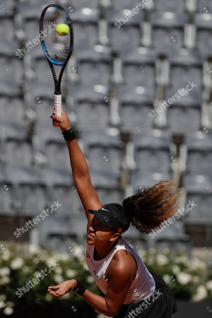 Japan's Naomi Osaka serves the ball during her match against Slovakia's Dominika Cibulkova at the Italian Open tennis tournament, in Rome, Thursday, May, 16, 2019