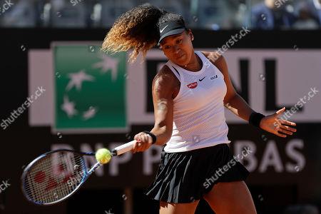 Japan's Naomi Osaka returns the ball during her match against Slovakia's Dominika Cibulkova at the Italian Open tennis tournament, in Rome, Thursday, May, 16, 2019