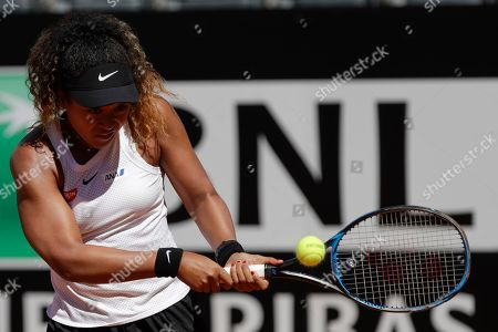 Japan's Naomi Osaka returns the ball during her match against Slovakia's Dominika Cibulkova at the Italian Open tennis tournament, in Rome, Thursday, May, 16, 2019