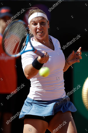 Slovakia's Dominika Cibulkova returns the ball during her match against Japan's Naomi Osaka at the Italian Open tennis tournament, in Rome, Thursday, May, 16, 2019