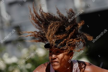 Japan's Naomi Osaka serves the ball during her match against Slovakia's Dominika Cibulkova at the Italian Open tennis tournament, in Rome, Thursday, May, 16, 2019