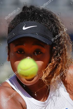 Japan's Naomi Osaka eyes the ball during her match against Slovakia's Dominika Cibulkova at the Italian Open tennis tournament, in Rome, Thursday, May, 16, 2019
